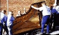 Bells Removals moving a piano for the Tasmanian Symphony Orchestra TSO