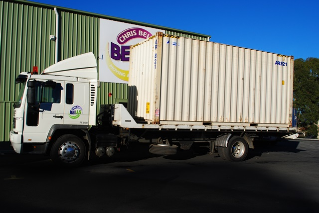 Tilt tray truck with removal container