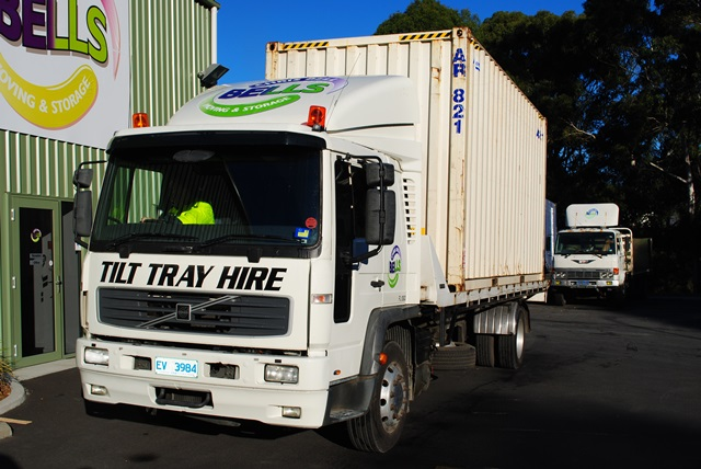 Tilt tray truck for moving removal shipping containers